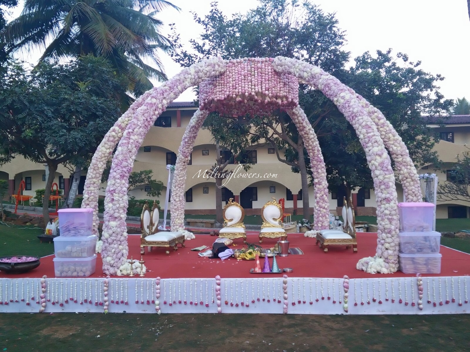 The transformation of mandap into an epitome of grandeur for Artificial flower decoration mandap