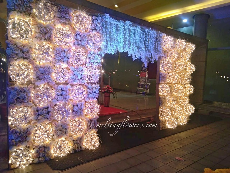 flower and fairy lights entrance decor