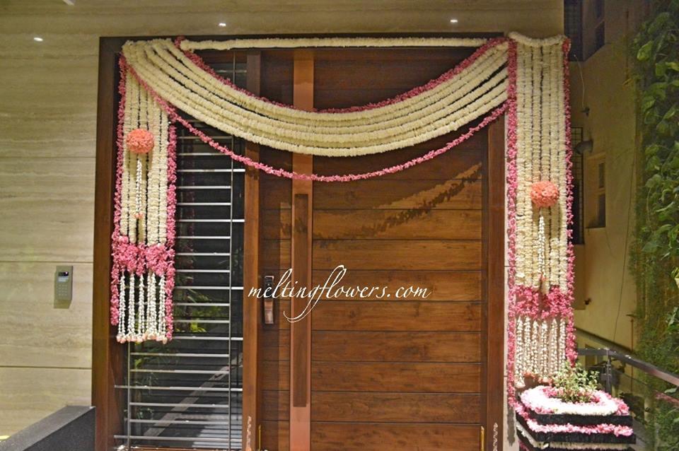 door decoration with flower garlands