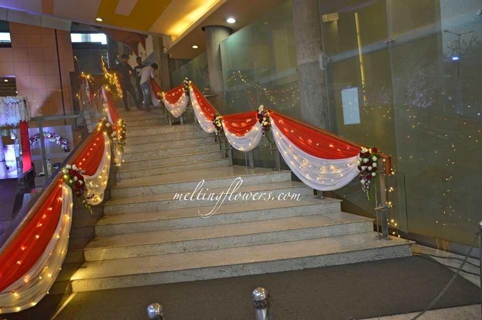 drapes and fairy light stair decor
